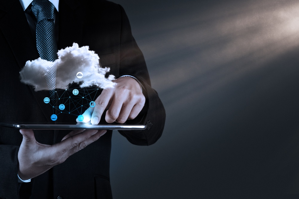 Businessman hand working with a Cloud Computing diagram on the new computer interface as concept-3